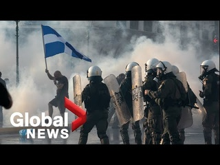Greek police clash with protesters at rally against COVID-19 vaccinations in Athens